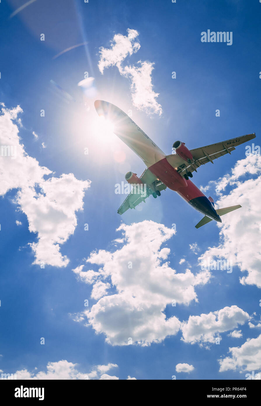 Airplane landing, view from bellow - Stock Image