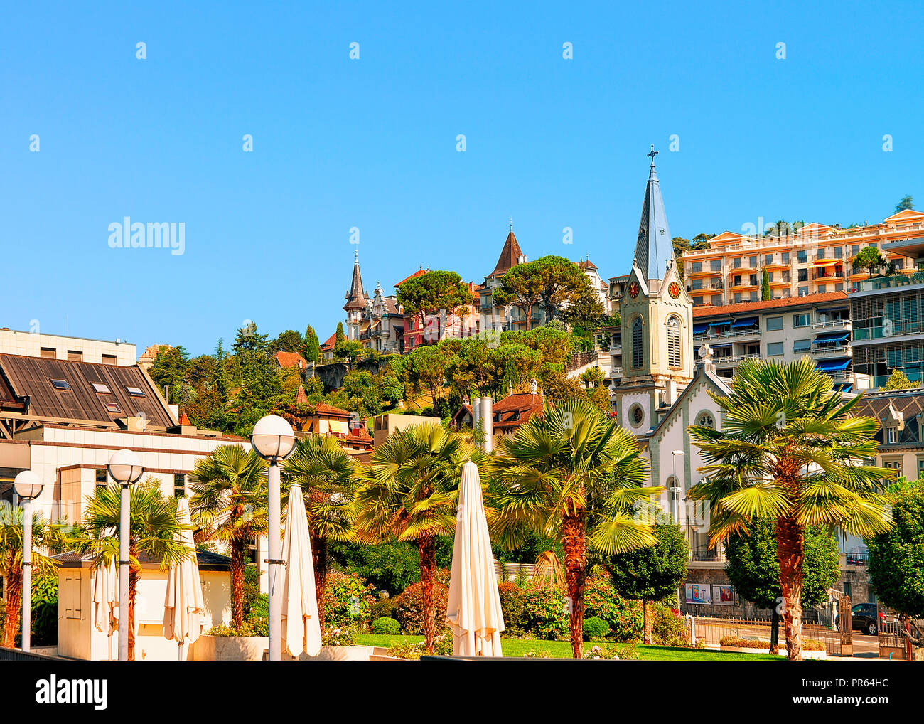 Montreux, Switzerland - August 28, 2016: Church clock tower on Geneva Lake in Montreux, Swiss Riviera - Stock Image