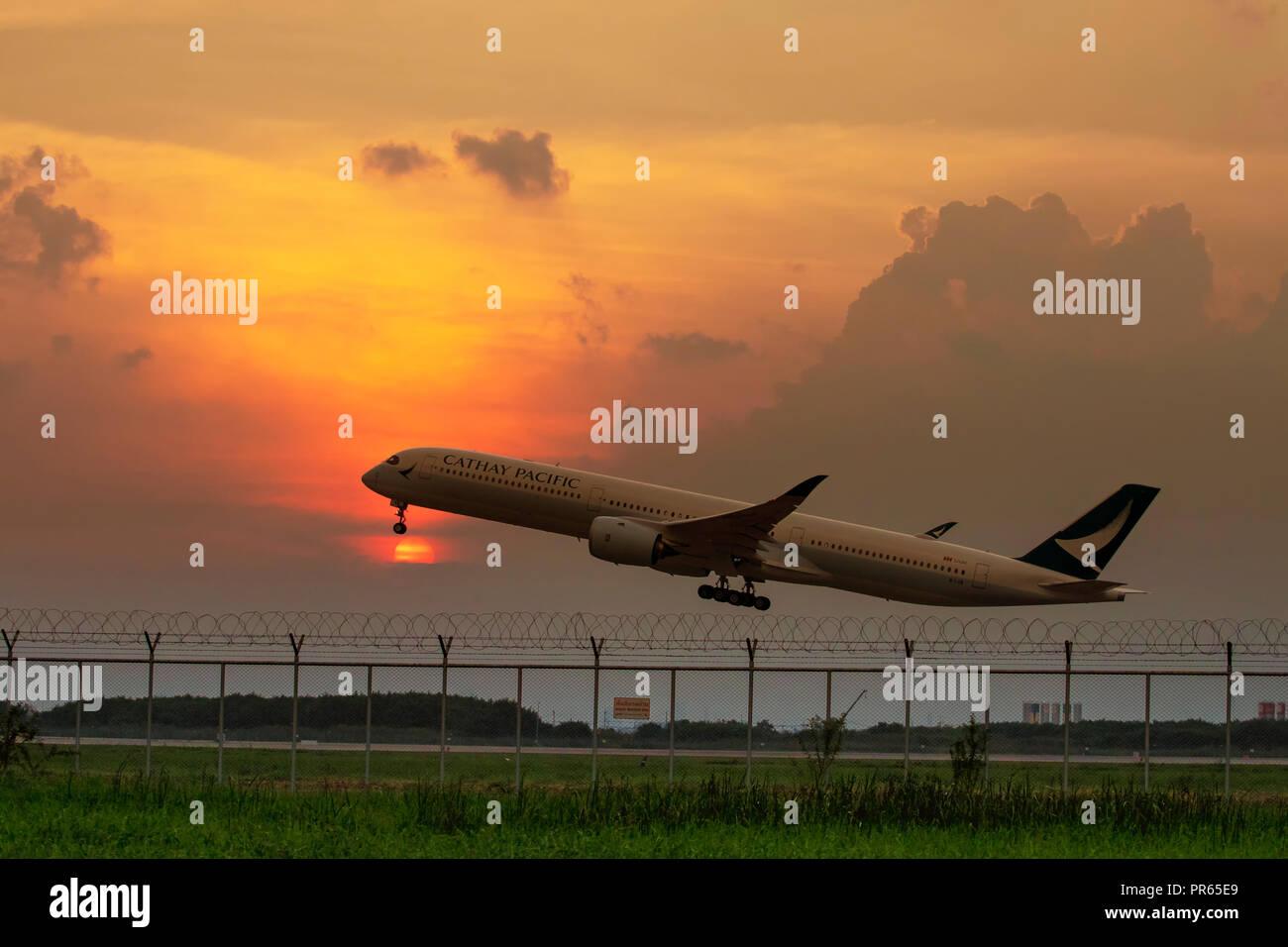 bangkok thailand - september29,2018 : cathay pacific plane take off from suvarnabhumi airport runway, suvarnabhumi airport is largest commercial airpo - Stock Image
