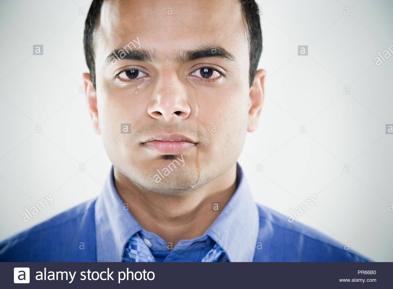 Close up of Indian man crying - Stock Image