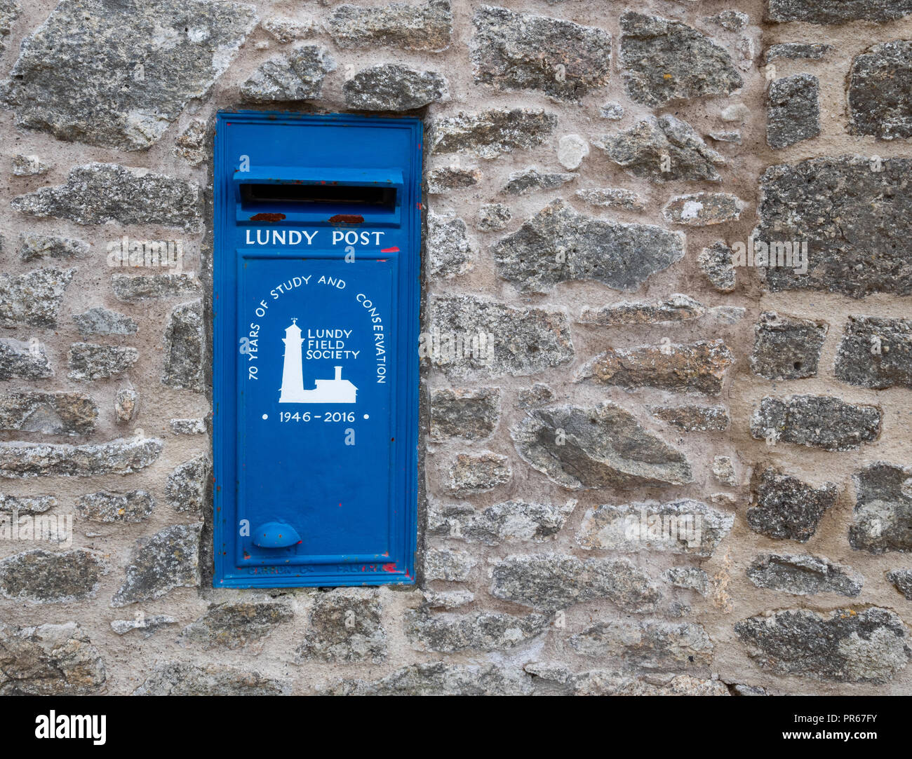 Blue post box on Lundy island which has its own postal service - Stock Image