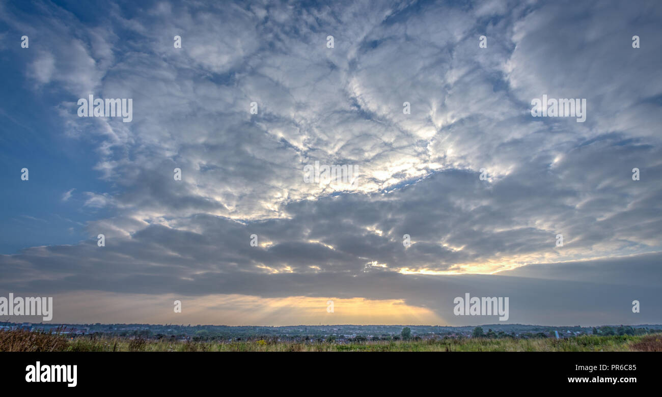 Sunset with crepuscular rays, Port Sunlight River Park, Wirral,Merseyside,UK Stock Photo