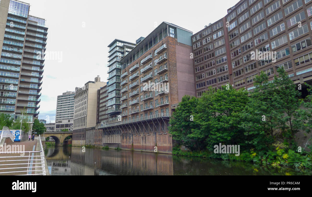 Apartment buildings on the River Irwell, Manchester city centre, uk. - Stock Image