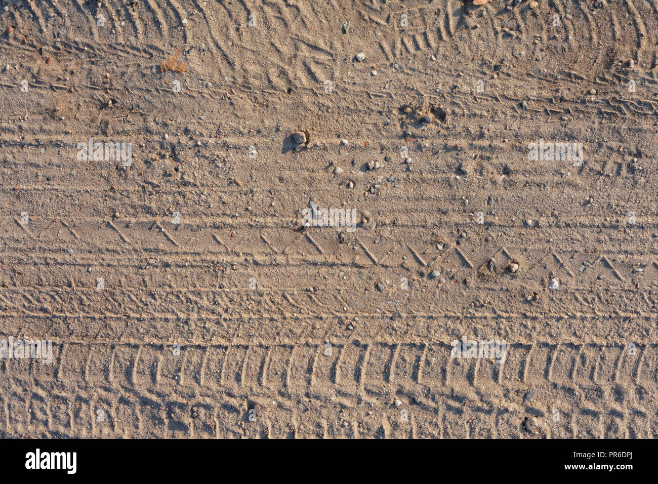 seamless dirt road texture background  Tracks of cars on the sand in