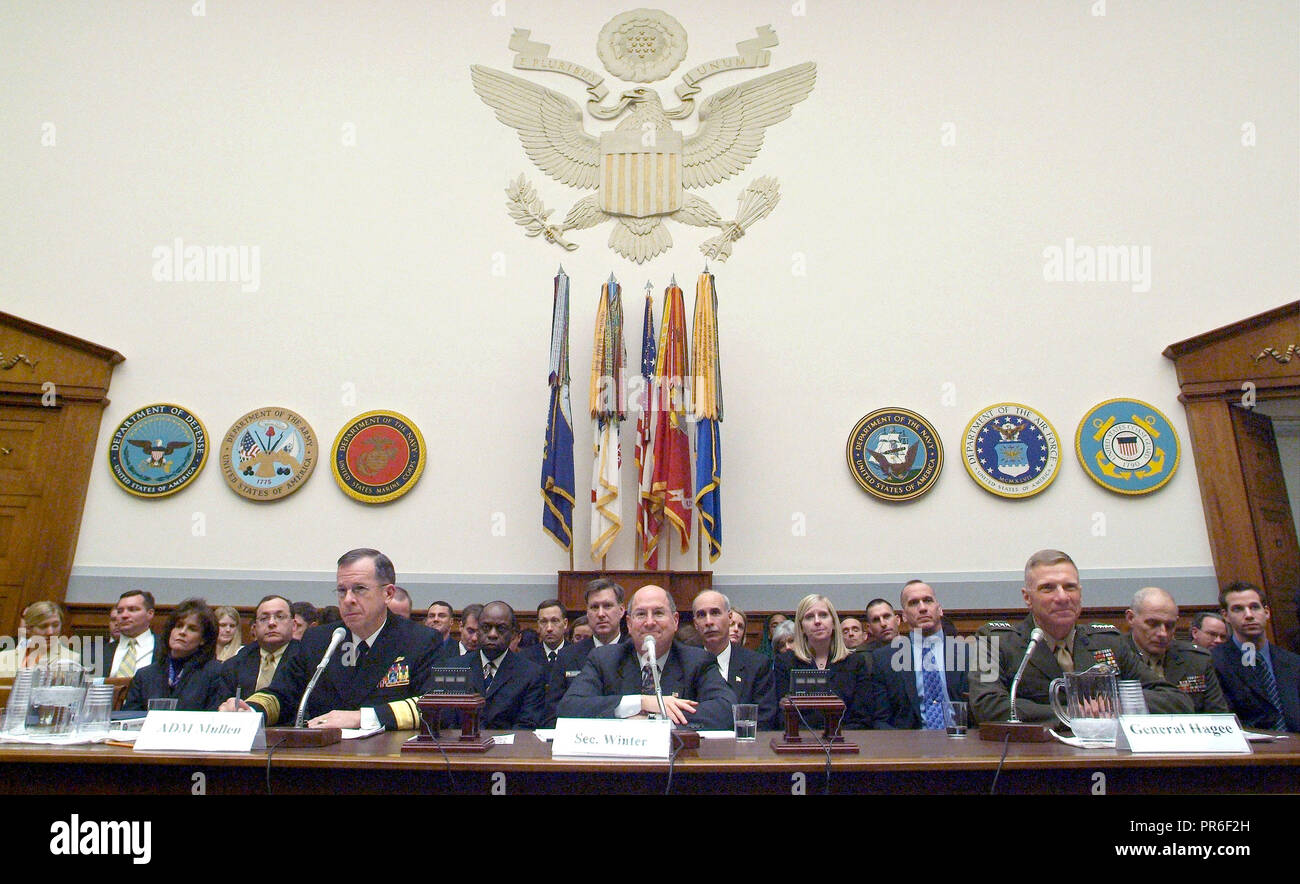 US Navy (USN) Top Officials appear before the House Armed Services Committee to give testimony and answer questions concerning the 2007 fiscal year National Defense Authorization budget request. Pictured foreground left-to-right: Chief of Naval Operations (CNO) USN Admiral (ADM) Michael G. Mullen, Secretary of the Navy (SECNAV), the Honorable Donald C. Winter and Commandant of the Marine Corps (CMC) US Marine Corps (USMC) General (GEN) Michael W. Hagee. Stock Photo
