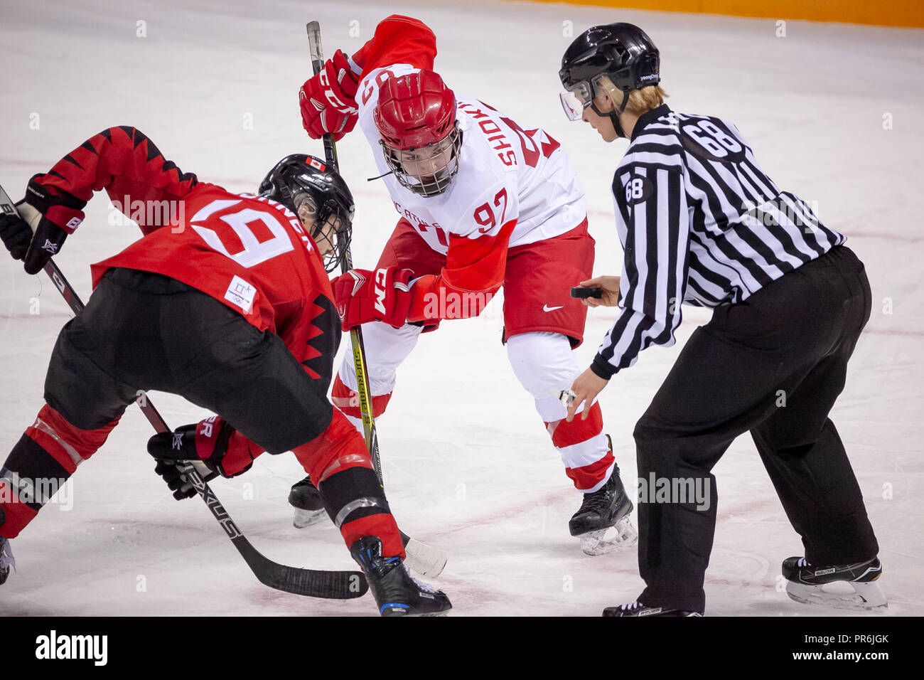 Anna Shokhina (OAR) and Brianne Jenner (CAN) faceoff during Team OAR vs Team Cananda competing in Women's hockey at the Olympic Winter Games PyeongCha - Stock Image