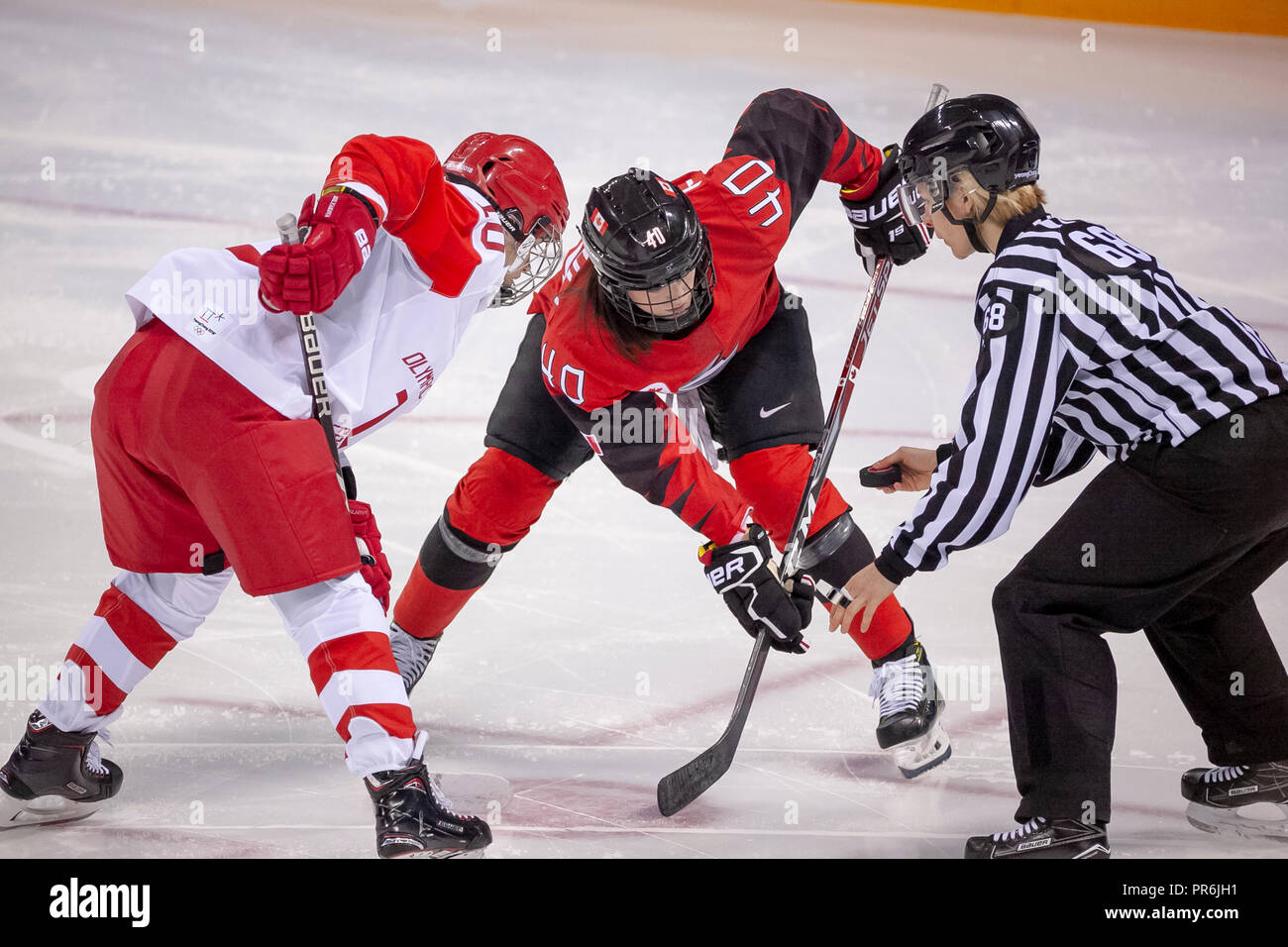 Liudmila Belyakova (OAR) and Blayre Turnbull (CAN) faceoff during Team OAR vs Team Cananda competing in Women's hockey at the Olympic Winter Games Pye - Stock Image