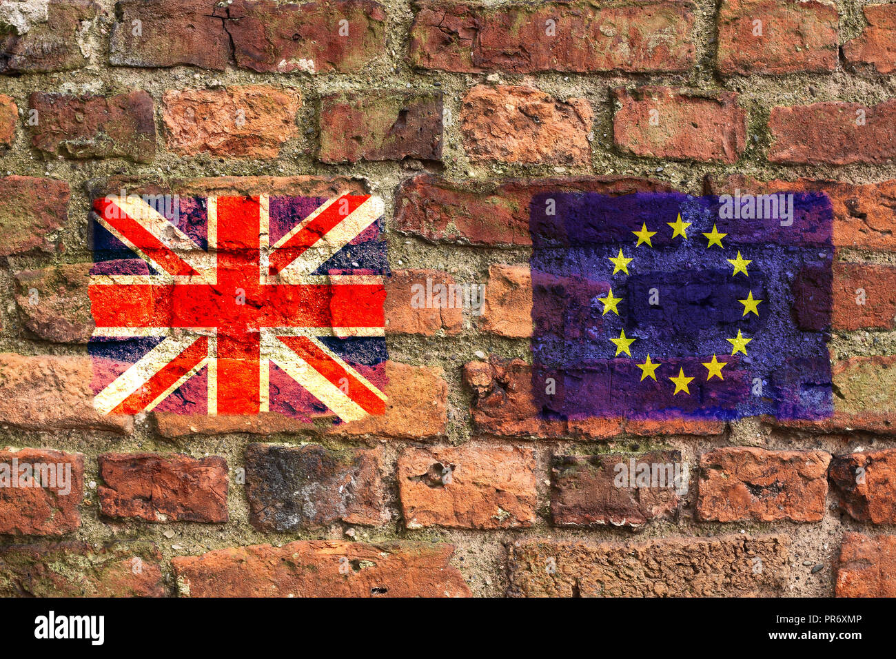 United Kingdom Union Jack and the European Union flags on a brick wall.  Concept that brexit negotiations have hit a brick wall. - Stock Image