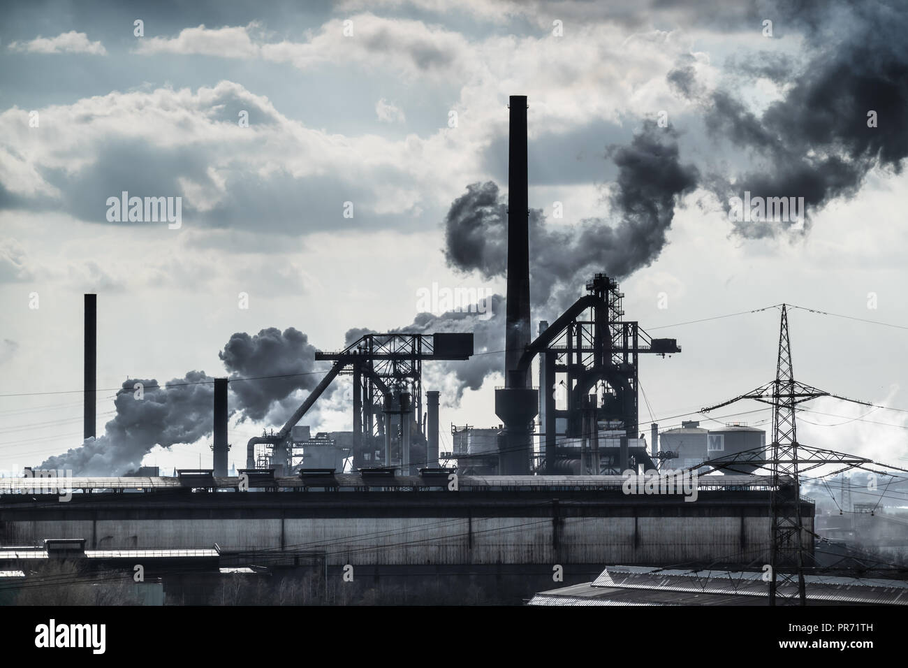 Industrial plant with lots of smoke in the Ruhr area in Germany - Stock Image