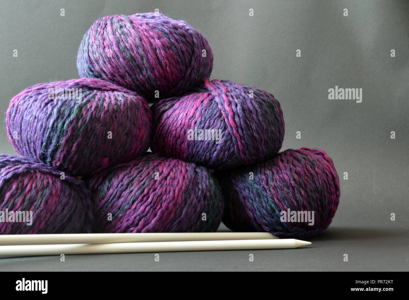 winter hobby, wool balls ready to be knitted - Stock Image