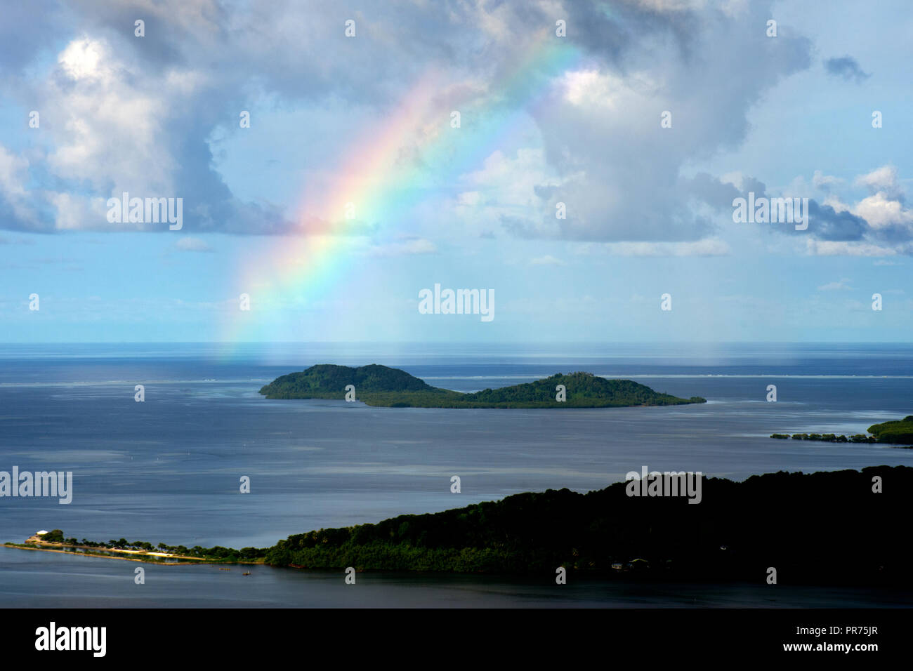Aerial view of the lagoon of Pohnpei with a rainbow, Federated States of Micronesia - Stock Image