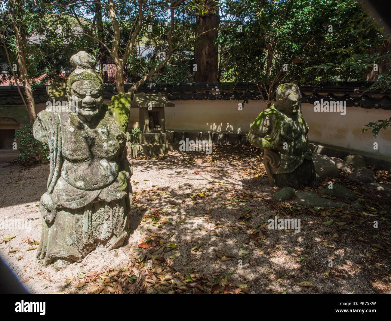 Nio temple guardians, crippled by decay, limbless torsos, at a local shinto shrine, Kunisaki Hanto, Oita, Kyushu, Japan - Stock Image