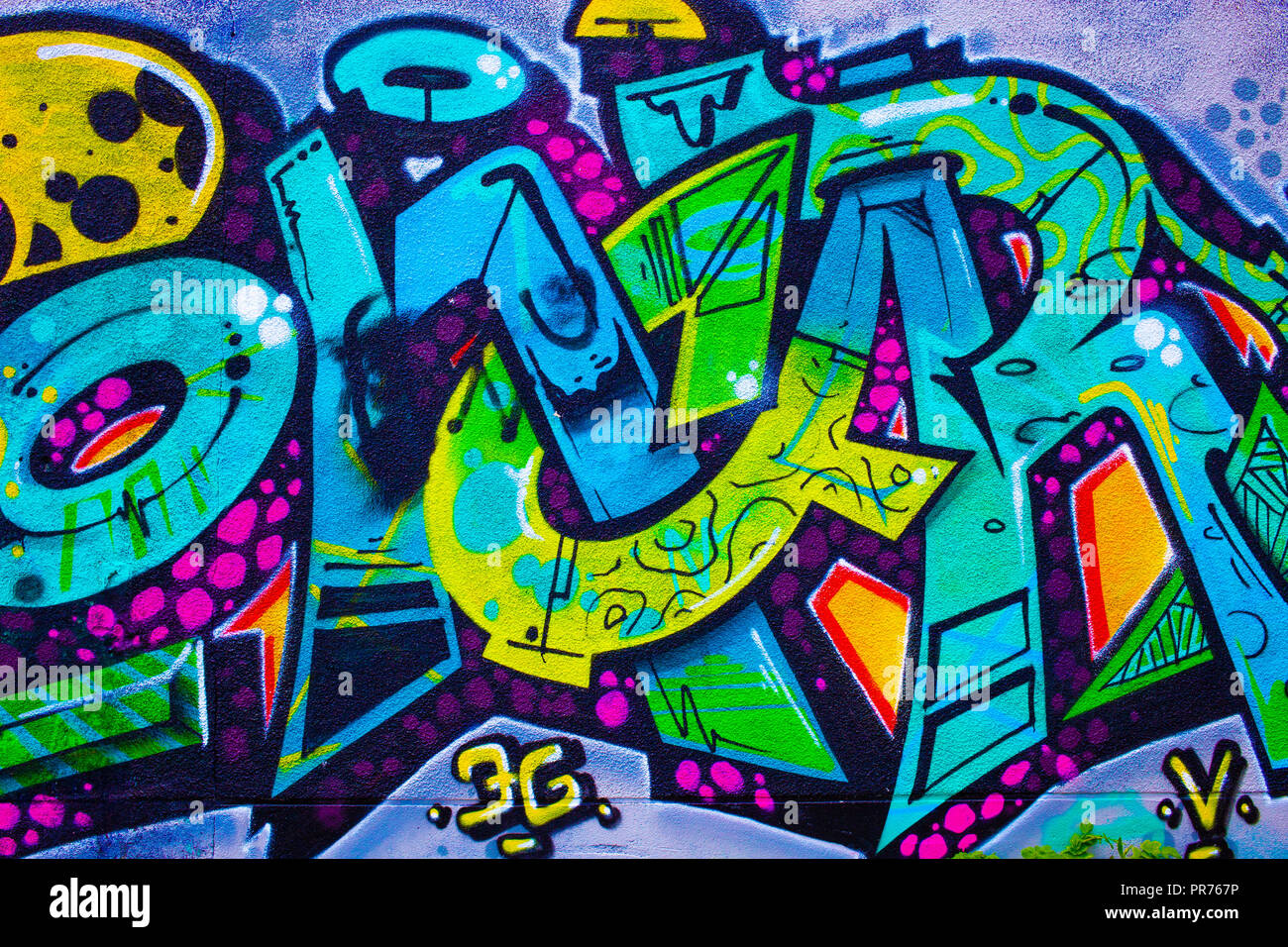 Detail Of A Colorful Graffiti On A Wall Abstract Background
