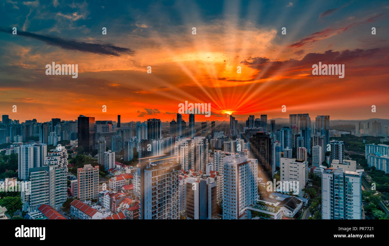 Dramatic Sunset Over Singapore City-State Skyline - Stock Image