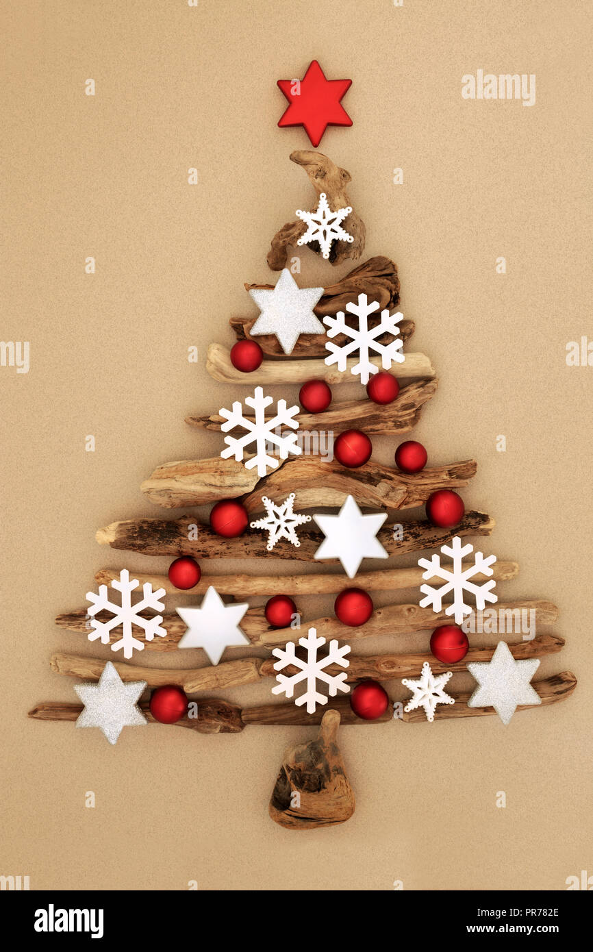 Abstract Driftwood Christmas Tree With Snowflake Star And Ball Bauble Decorations Red Bauble Star On Mottled Cream Background Stock Photo Alamy