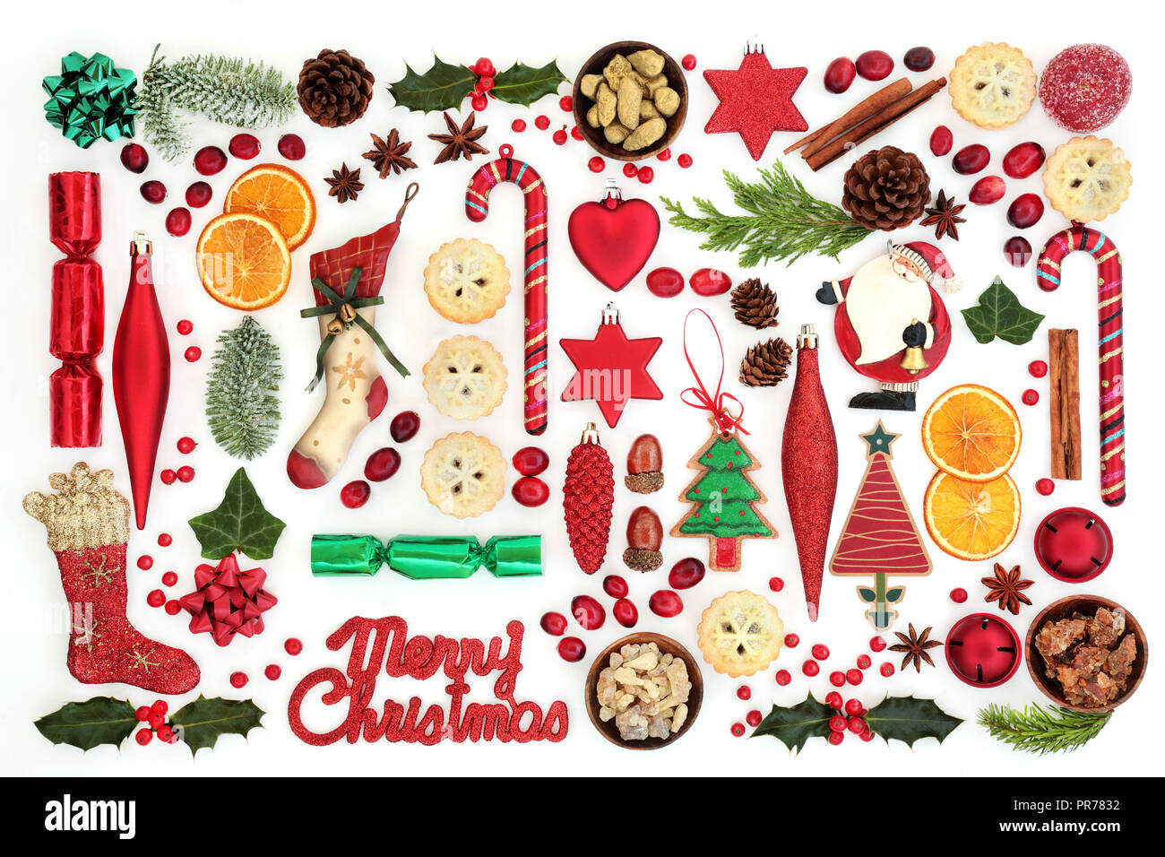Merry Christmas sign with retro and new tree decorations, food, winter flora, seasonal symbols and gold, frankincense and myrrh. - Stock Image