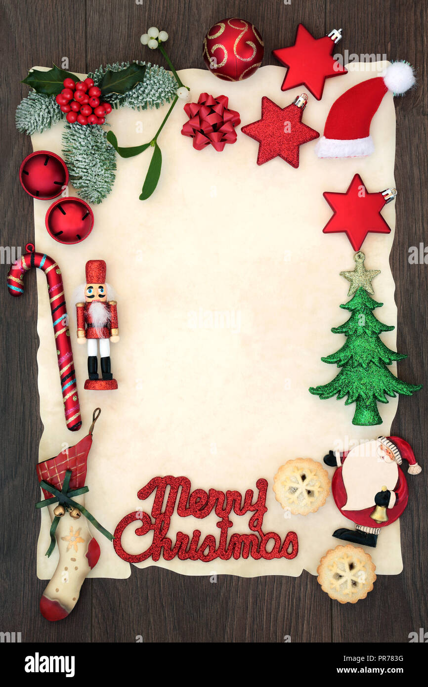 Blank letter to Santa Claus or party invitation with Merry Christmas sign on blank parchment paper with decorations, mince pies  and winter flora. - Stock Image