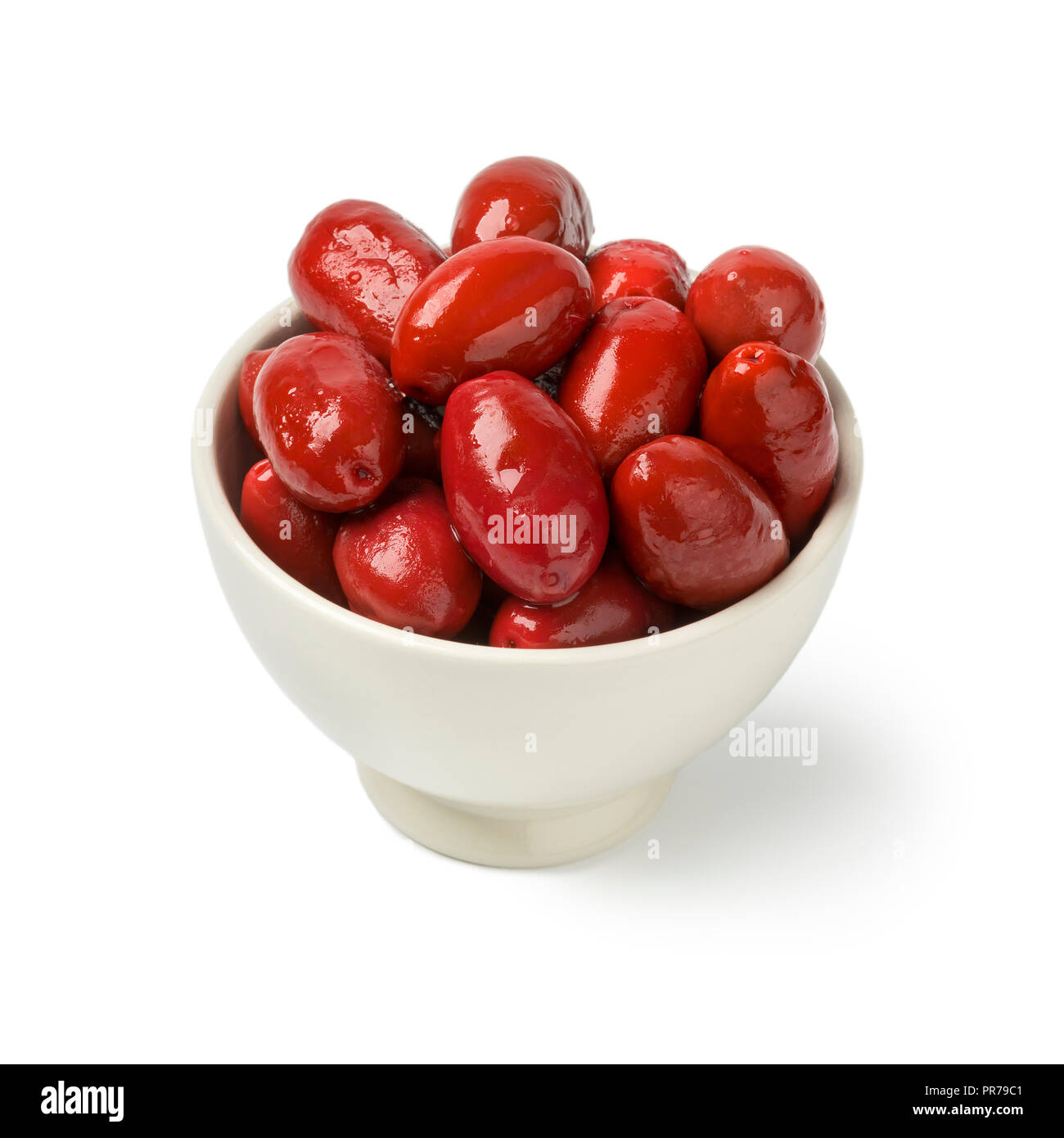 Single bowl with red Italan Bella olives isolated on white background - Stock Image
