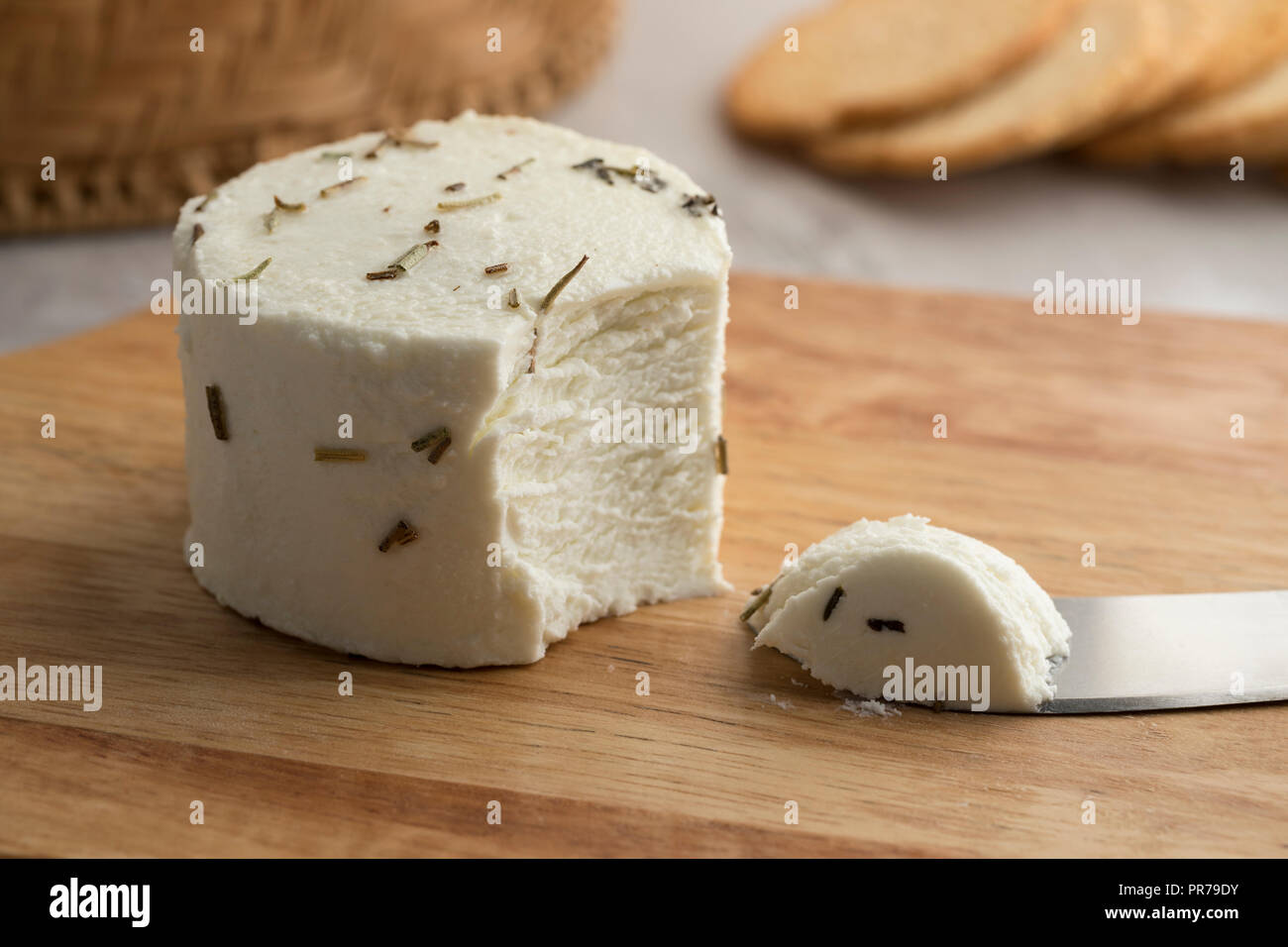Preserved white organic Dutch goat cheese and herbs as a snack - Stock Image