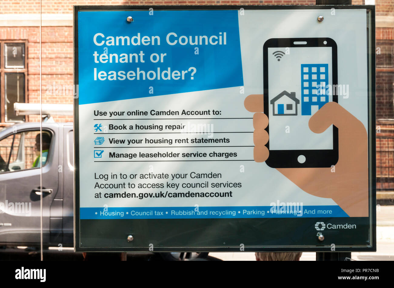 Poster at a bus stop advertises the Camden Account app aimed at Camden Council housing tenants. - Stock Image
