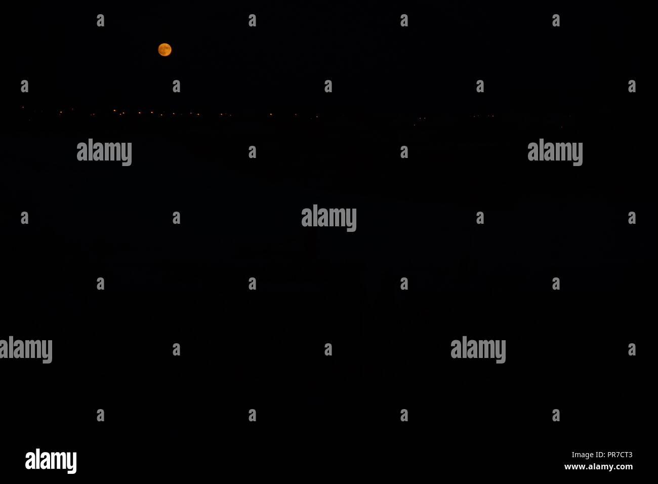 full moon and light lanterns in black sky - Stock Image