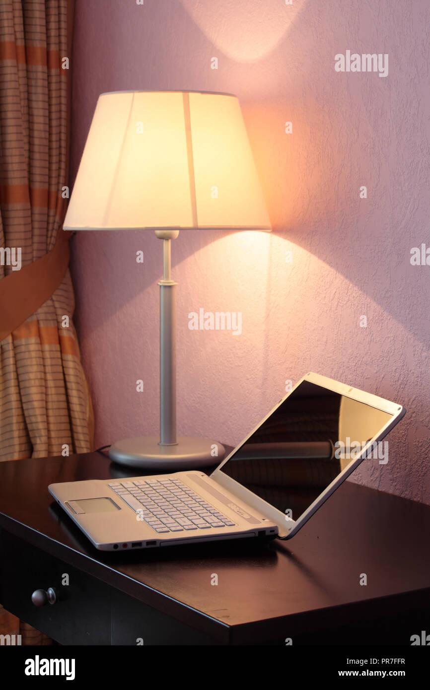 Laptop On A Table Under Desk Lamp Stock Photo 220827371 Alamy