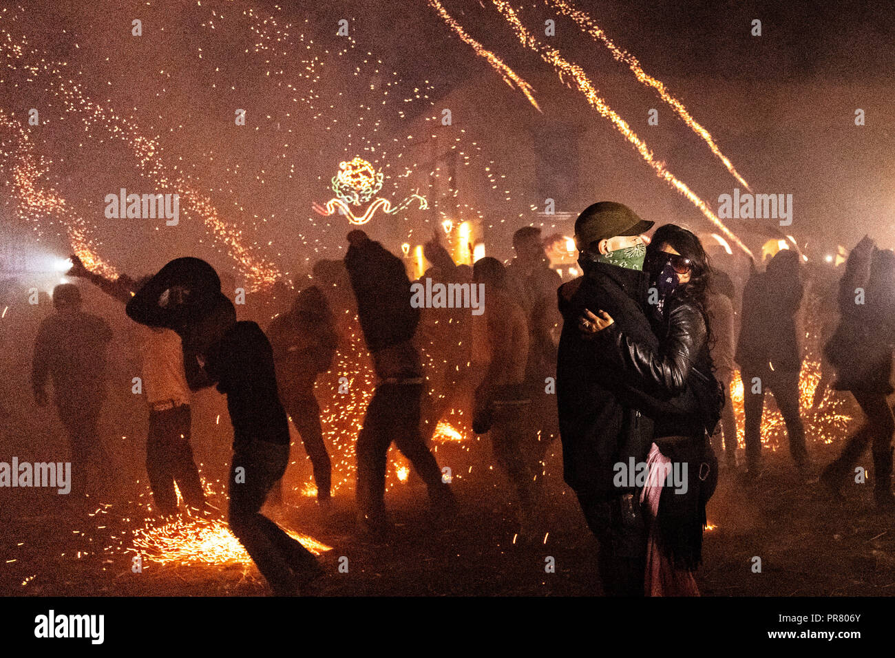 San Miguel de Allende, Mexico. 29th Sept 2018. A couple slow dances as dozens of sky rockets explode around them during the Alborada festival September 29, 2018 in San Miguel de Allende, Mexico. The unusual festival celebrates the cities patron saint with a two hour-long firework battle at 4am representing the struggle between Saint Michael and Lucifer. Credit: Planetpix/Alamy Live News - Stock Image