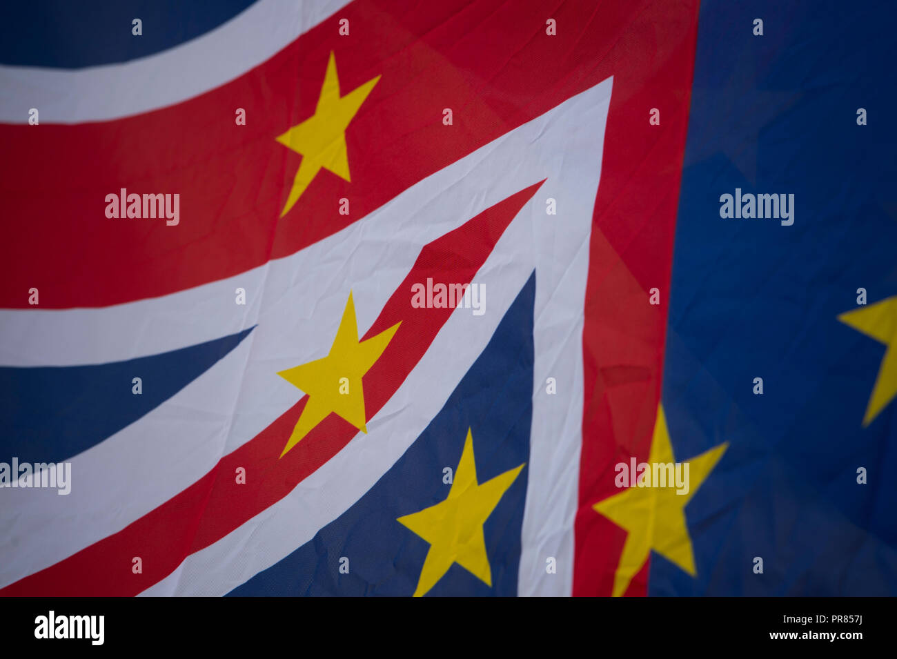 Birmingham, UK. 30th September 2018. A flag featuring elements of both the flag of the European Union and the UK's Union Flag, is flown at an anti-Brexit rally in Birmingham's Victoria Square near to the Conservative Party Conference in Birmingham. © Russell Hart/Alamy Live News. - Stock Image