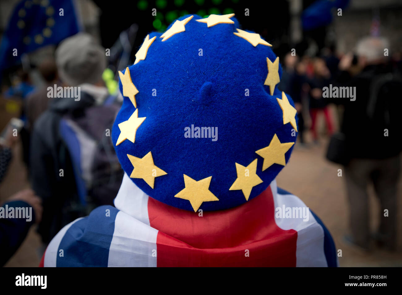Birmingham, UK. 30th September 2018. An attendee wears a beret hat based on the flag of the European Union at an anti-Brexit rally in Birmingham's Victoria Square near to the Conservative Party Conference in Birmingham. © Russell Hart/Alamy Live News. - Stock Image
