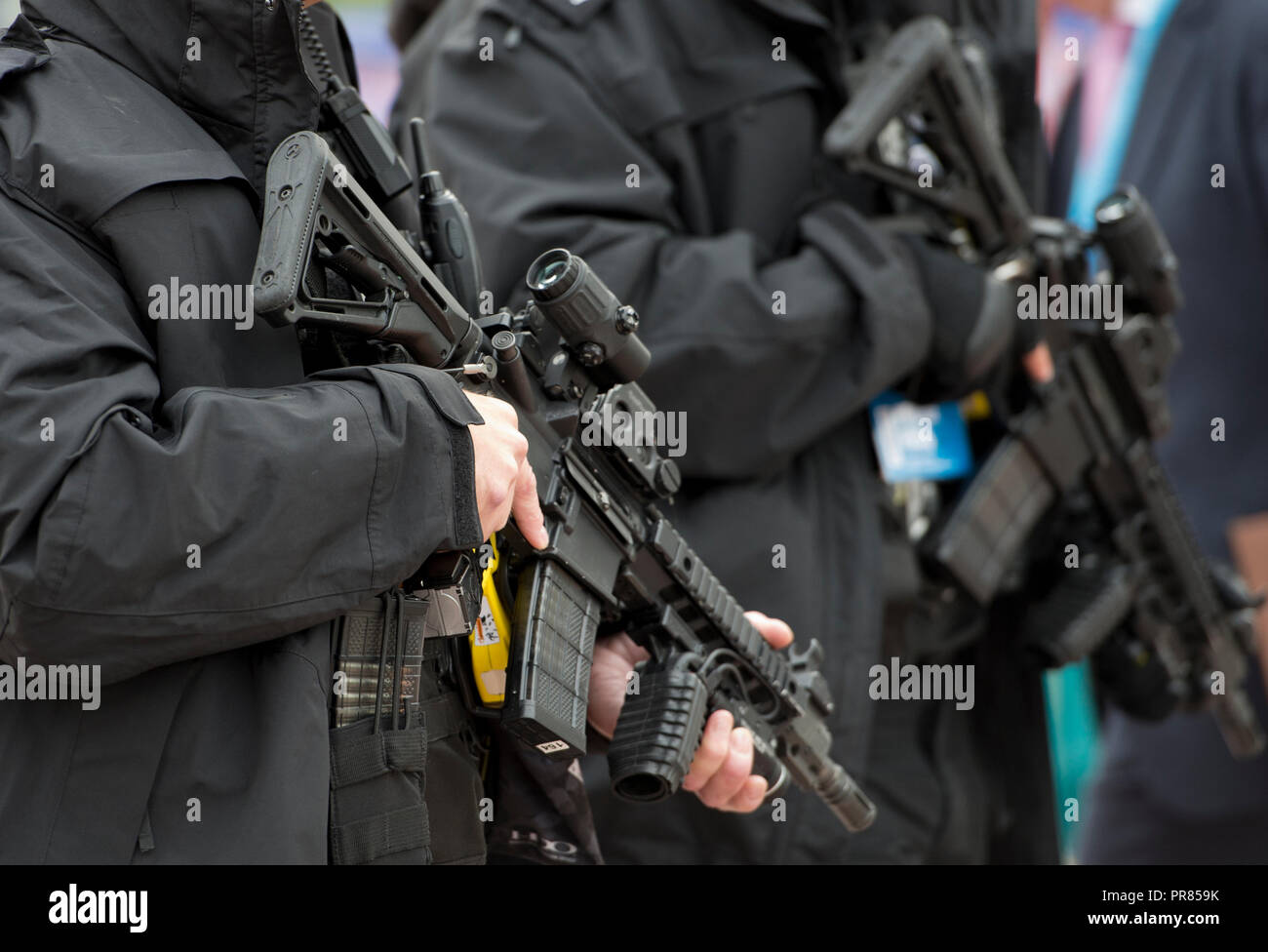 Birmingham, UK. 30th September 2018. Armed police holding semi-automatic rifles near the entrance to the Conservative Party Conference in Birmingham. © Russell Hart/Alamy Live News. - Stock Image