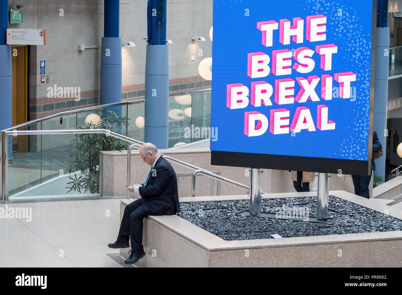 Birmingham, UK. Birmingham, UK. 30 September 2018 - An attendee sits in front of a 'The best Brexit deal' sign in Conservative Party Conference 2018 Credit: Benjamin Wareing/Alamy Live News Credit: Benjamin Wareing/Alamy Live News Stock Photo
