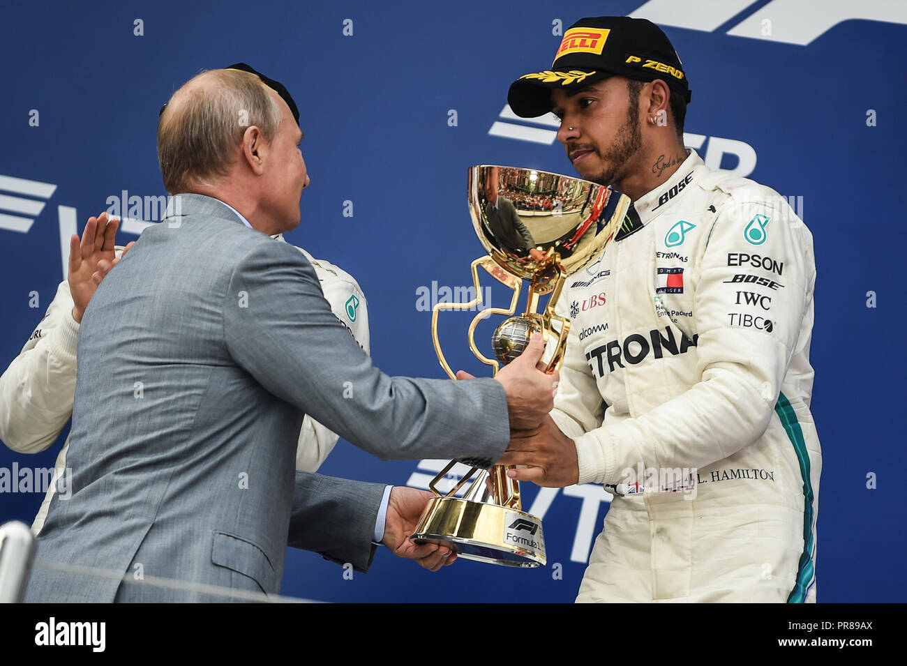 Sochi. 30th Sep, 2018. The president of Russia Vladimir Putin (L) awards Lewis Hamilton of Mercedes after the Formula One Russian Grand Prix at the Sochi Autodrom circuit in Sochi on September 30, 2018. Credit: Evgeny Sinitsyn/Xinhua/Alamy Live News - Stock Image