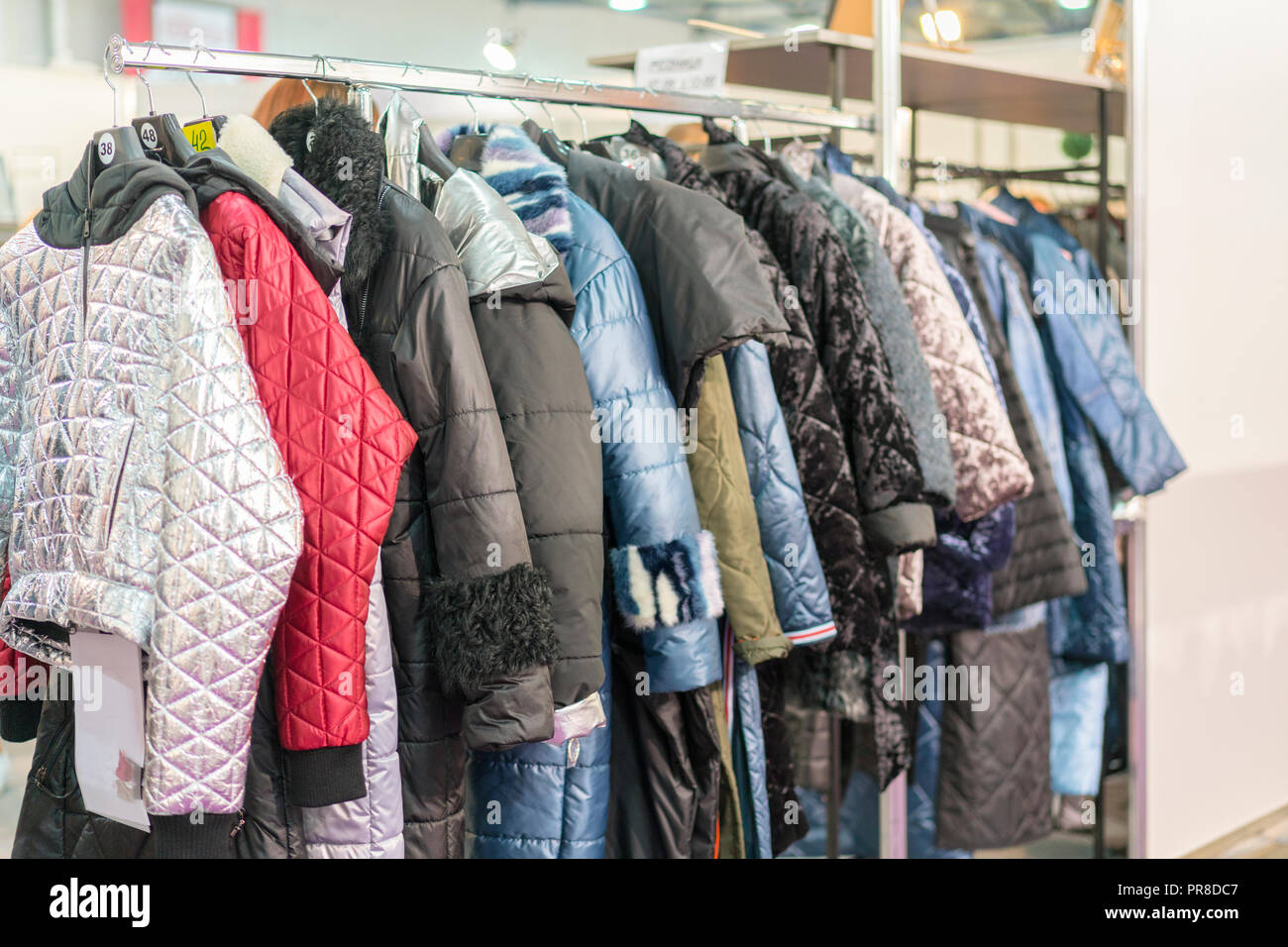 Winter Jacket in Winter Sale on a clothes rack. Women's