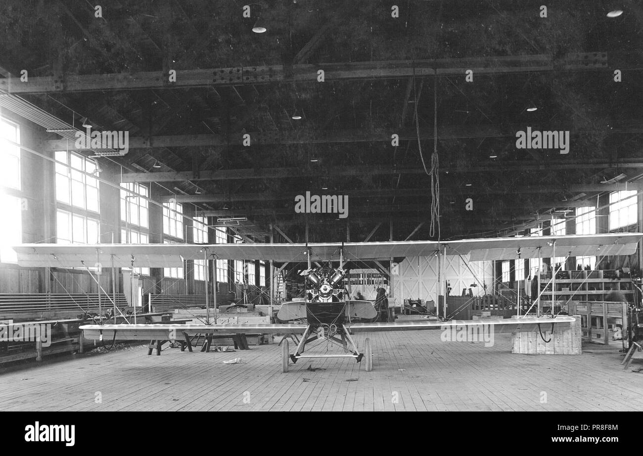 4/12/1918 - Wilbur Wright Aviation Field, Fairfield, Ohio. Assembling department; aero repair. J.N.4.D. plane with Ox5 motor in for repairs. It is a Curtiss elementary training plane. - Stock Image