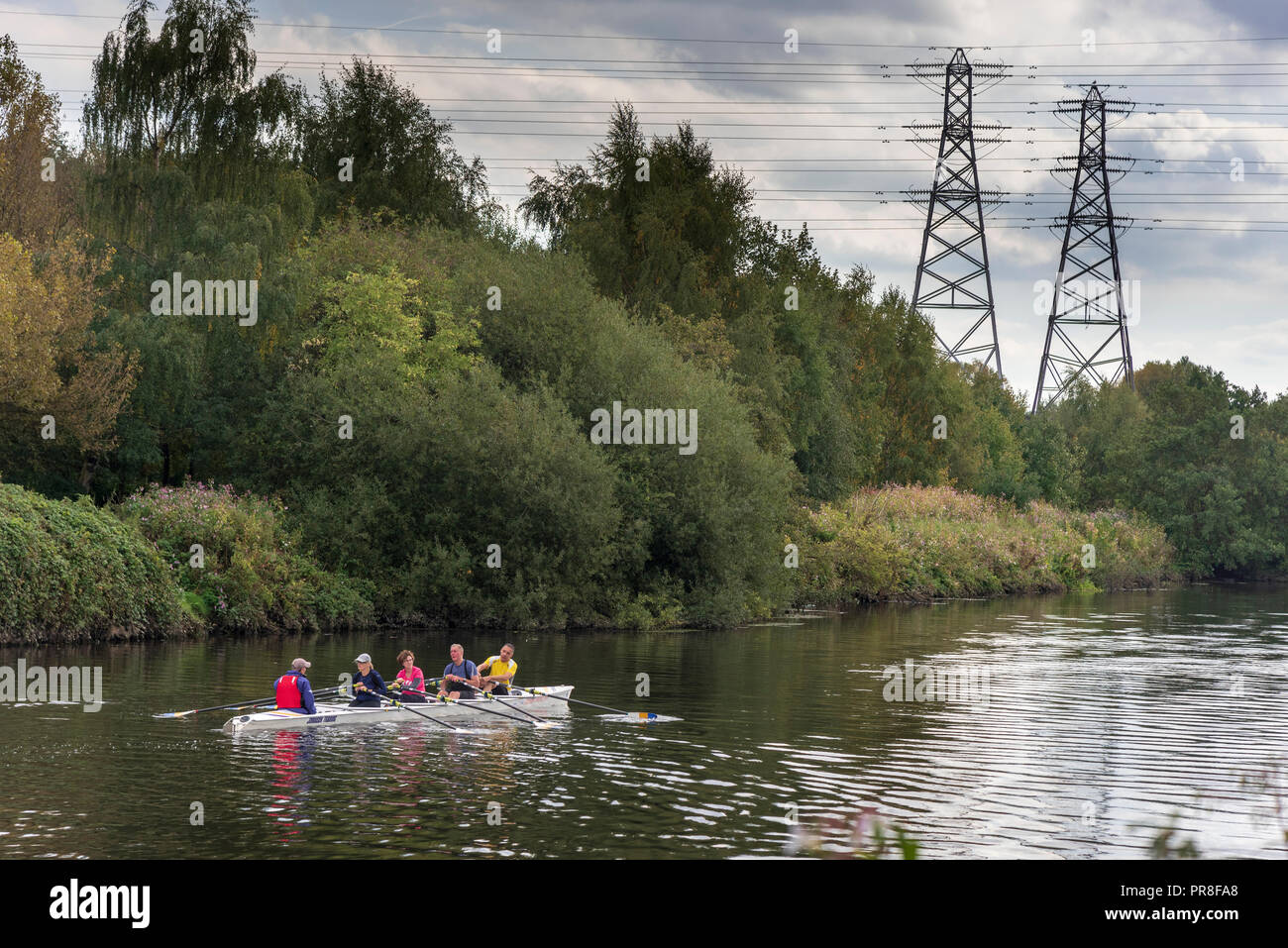 River Mersey at Latchford, Warrington. Rowers Elctricity pylons. - Stock Image