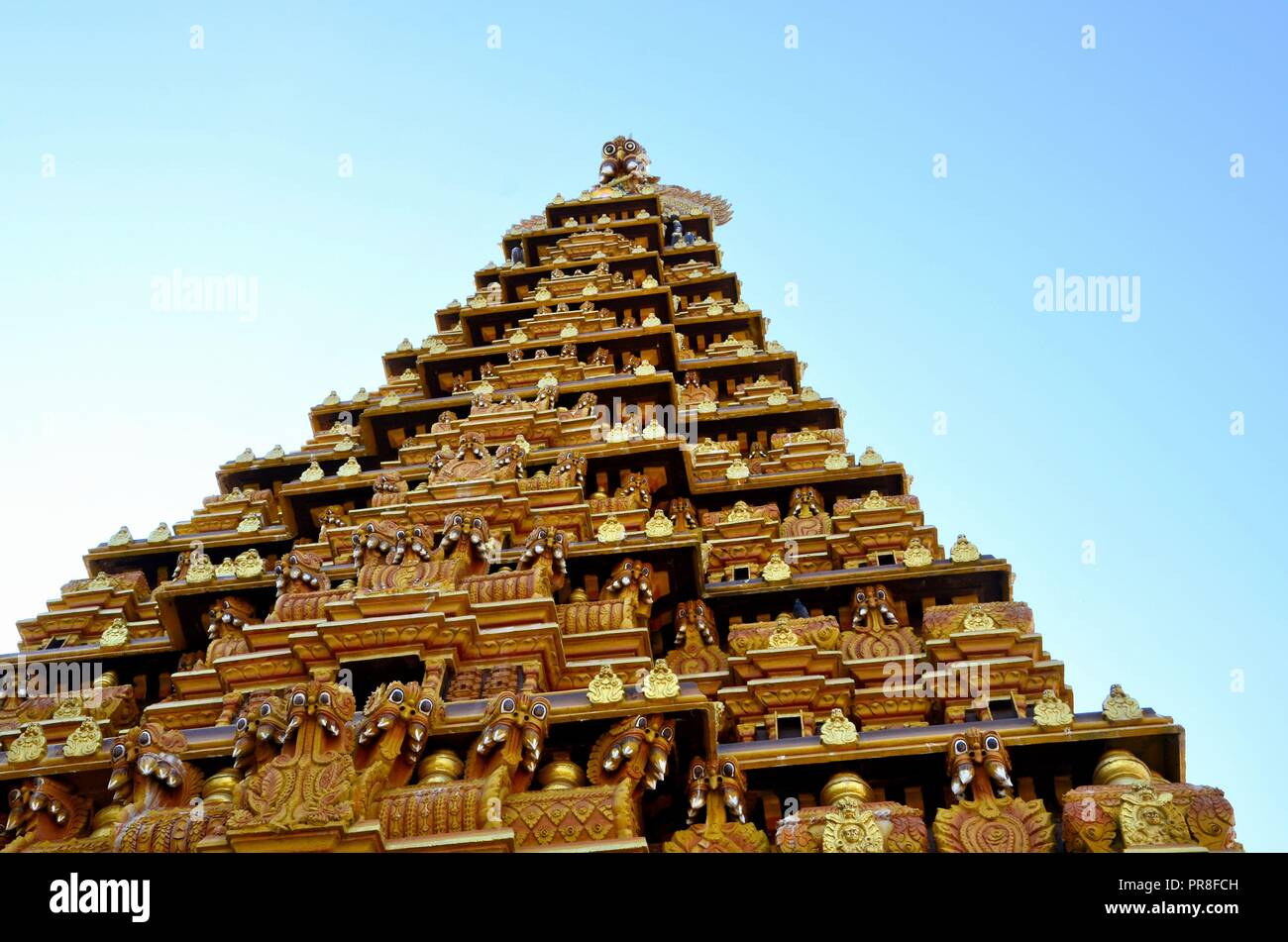 Ornate gopuram pagoda tower with sculpture gods at Nallur Kandaswamy Kovil  Hindu temple Jaffna Sri Lanka - Stock Image