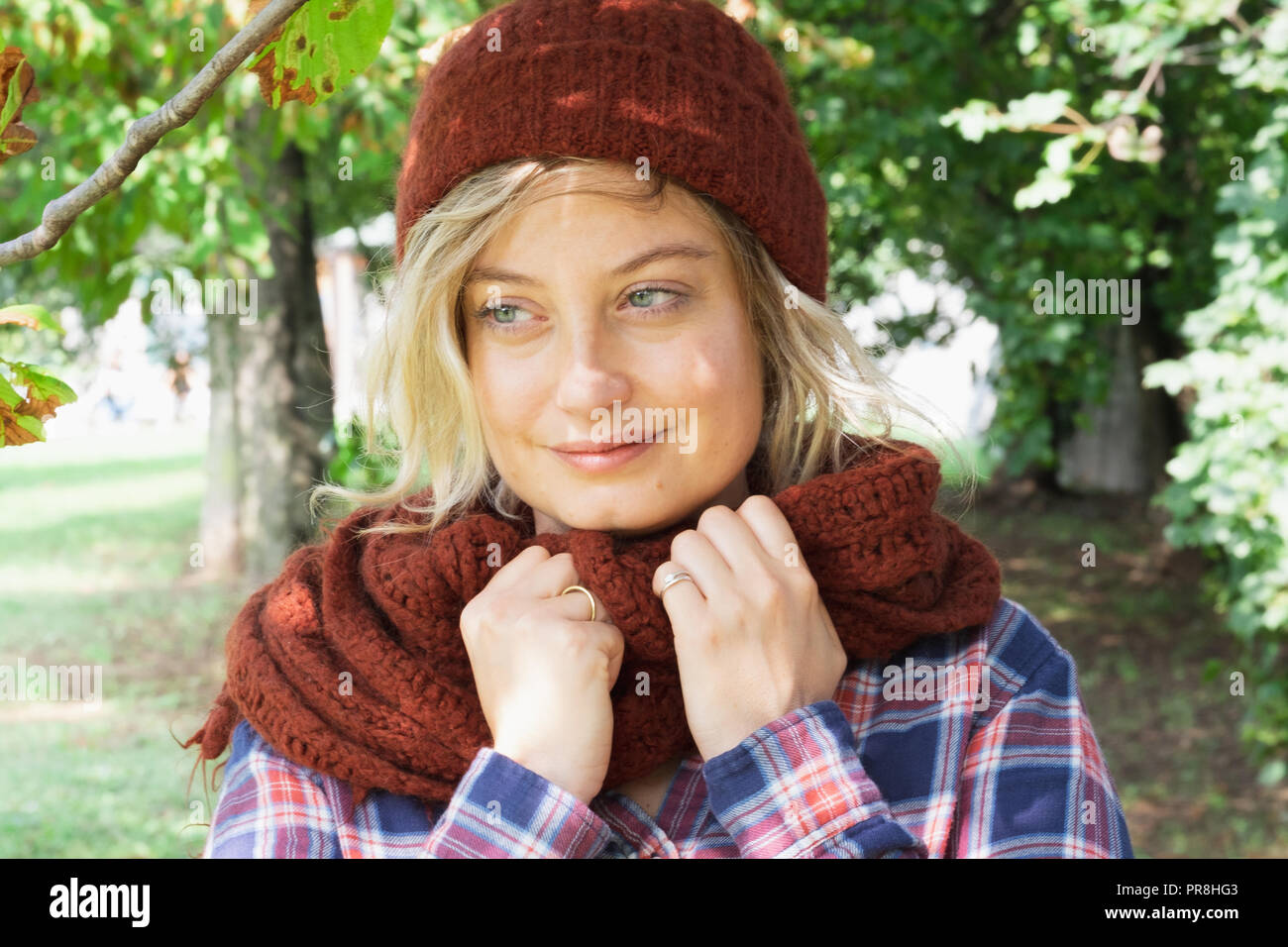 Girl during cold day wearing warm clothes outdoor - Stock Image