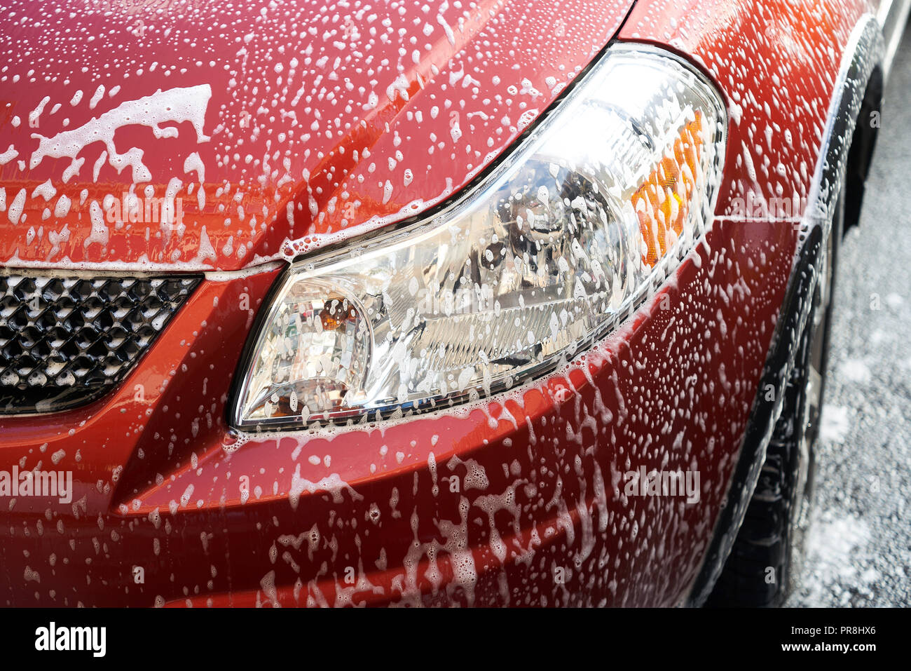 Montreal,Canada 29,September,2018.Soap suds on an automobile. Credit:Mario Beauregard/Alamy Live News - Stock Image