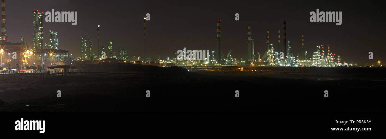 Big oil refinery at night with interesting light - Panorama Stock Photo