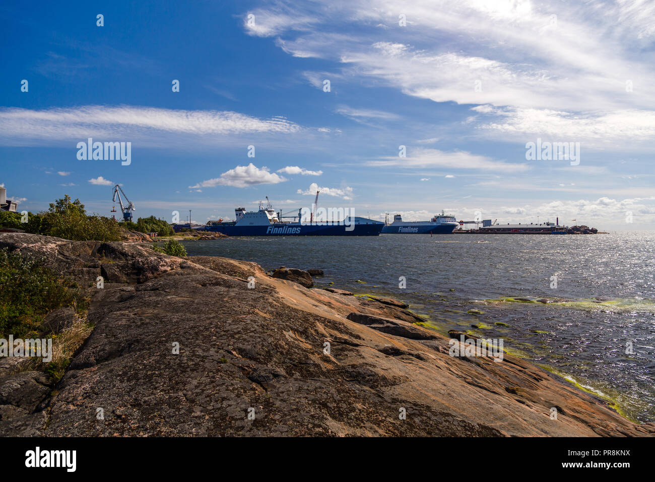 Editorial 08.18.2018 Hanko Finland, Port with cargo ships at the pier on a sunny day - Stock Image