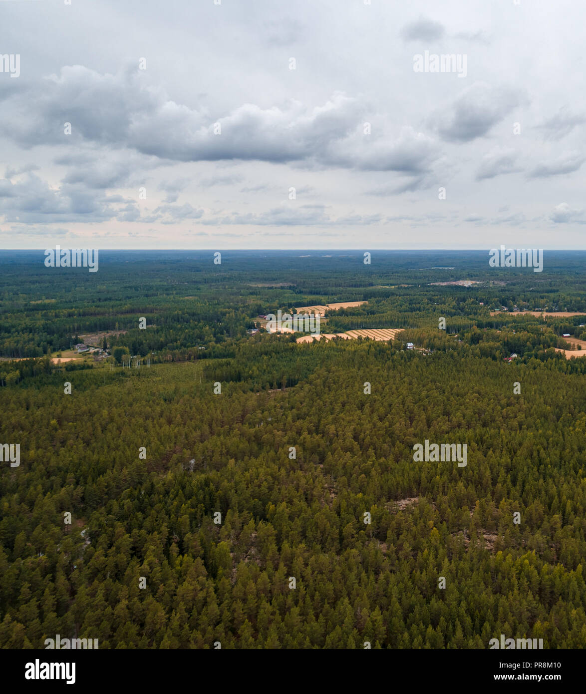 Aerial view from high altitude of the forest outside Tammisaari Finland on a day without sunshine - Stock Image