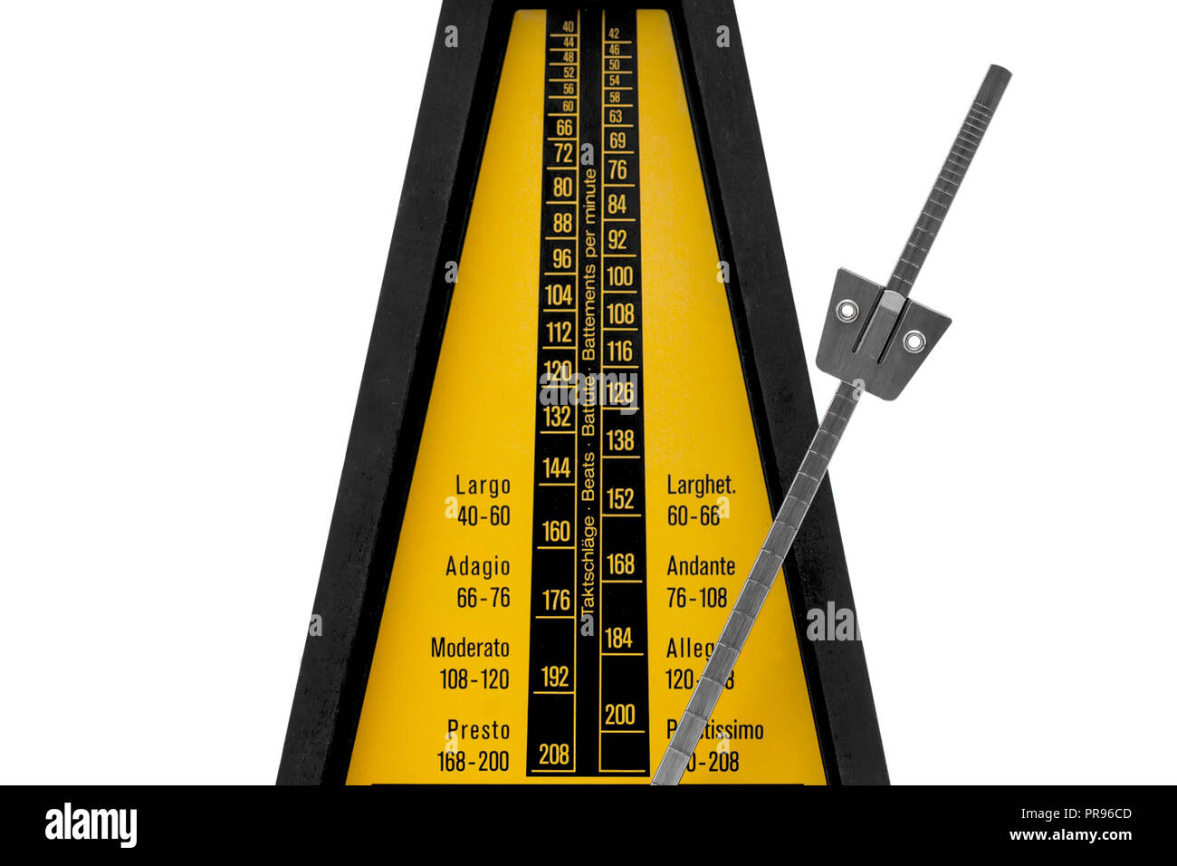 mechanical brown antique metronome on white background - Stock Image