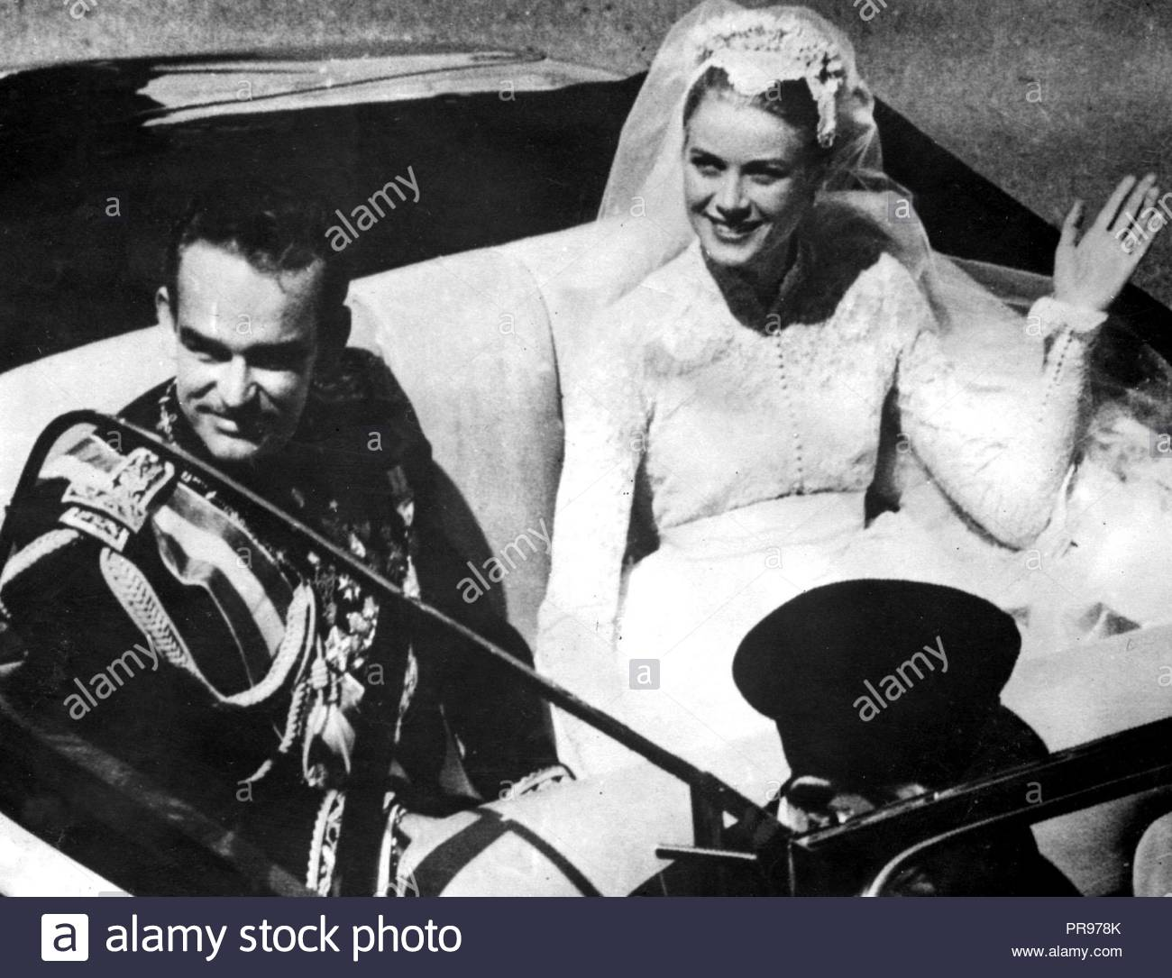 File photo dated 19/04/1956 of Grace Kelly and Prince Rainier of Monaco on their wedding day. A bridal expert has suggested that Princess Eugenie should opt for an elegant and simple wedding dress to create a memorable royal look, rather than going for over-the-top drama. - Stock Image