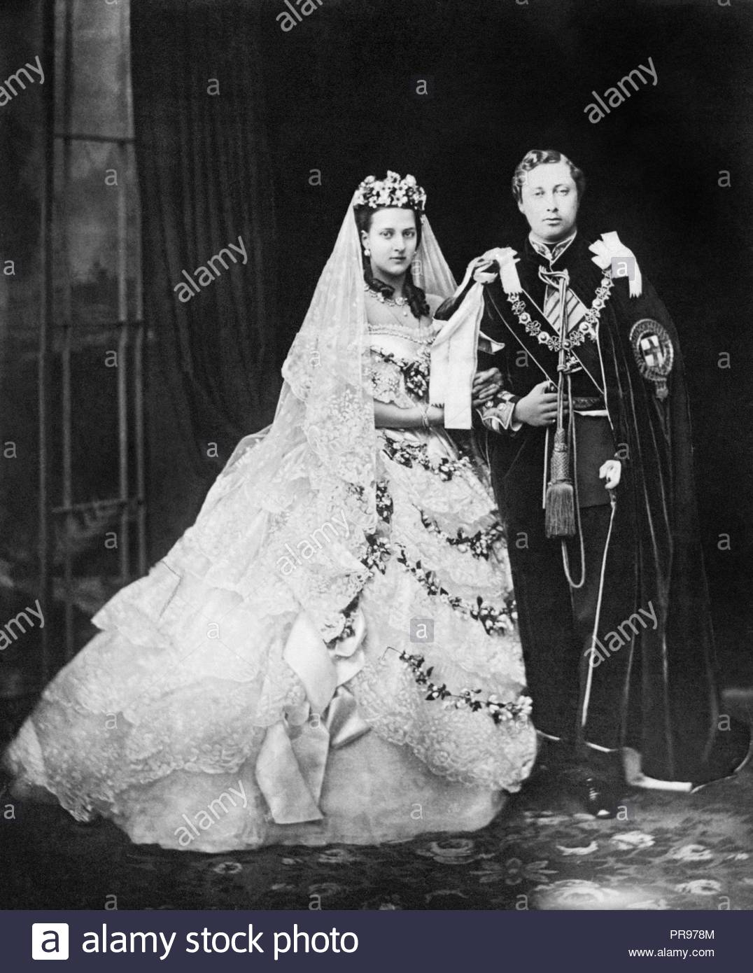 File photo dated 10/03/1863 of Edward, Prince of Wales (later King Edward VII), and his bride, Princess Alexandra of Denmark, after their wedding at Windsor castle as Princess Eugenie and fiance Jack Brooksbank are following in the footsteps of the Duke and Duchess of Sussex, Earl of Wessex and the QueenÕs eldest grandson Peter Phillips by marrying in St GeorgeÕs Chapel. - Stock Image