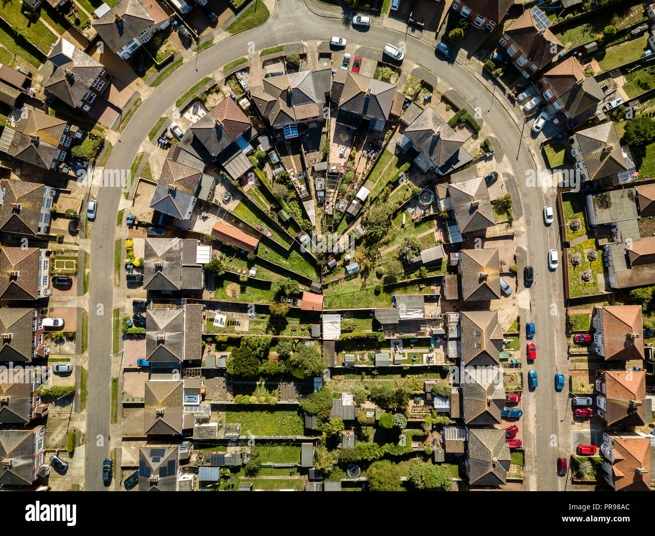 Aerial view of suburban houses in Ipswich, UK. U shaped street. Nice sunny day. Stock Photo