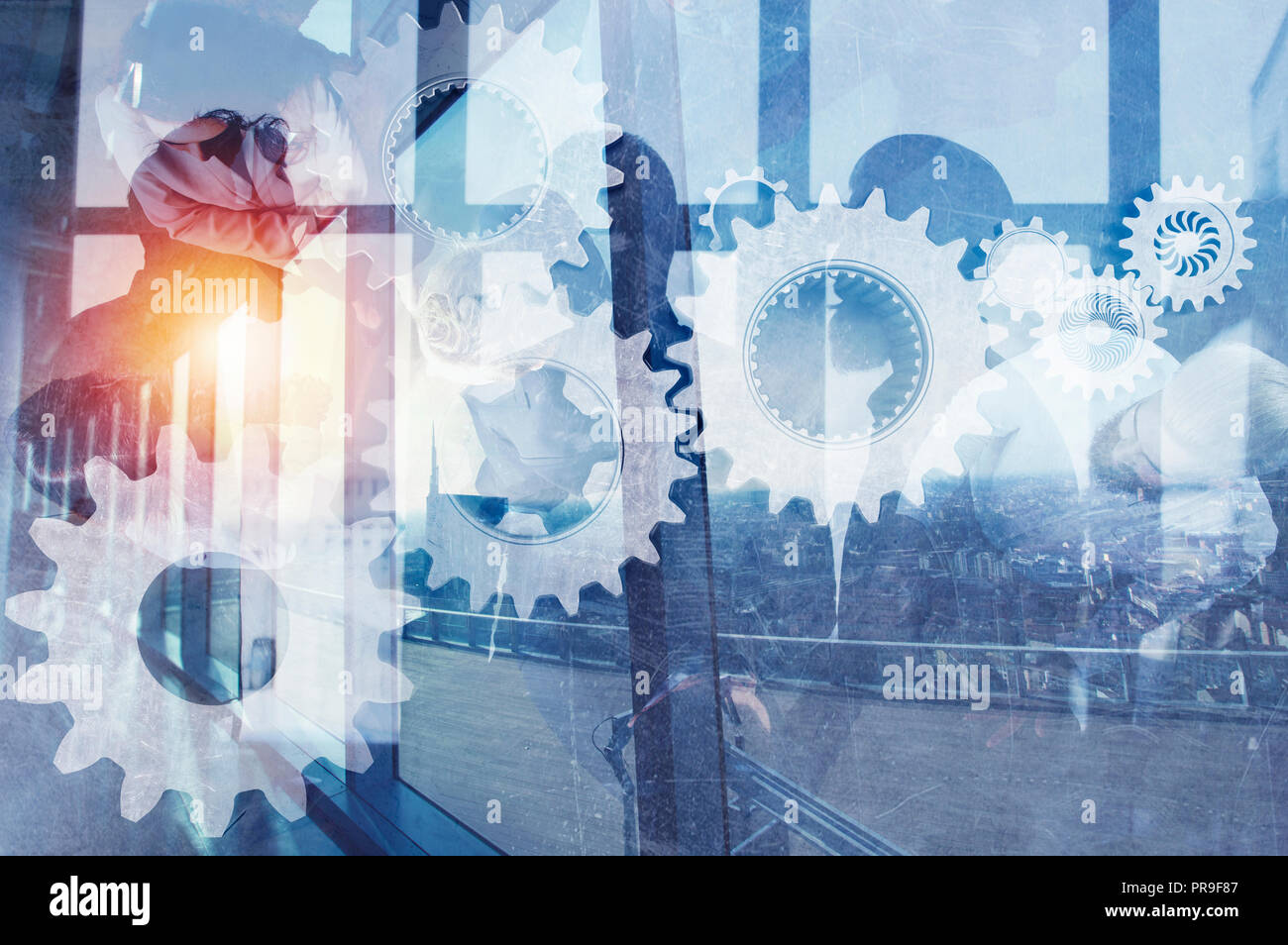 Business team with gears system. Teamwork, partnership and integration concept. double exposure - Stock Image