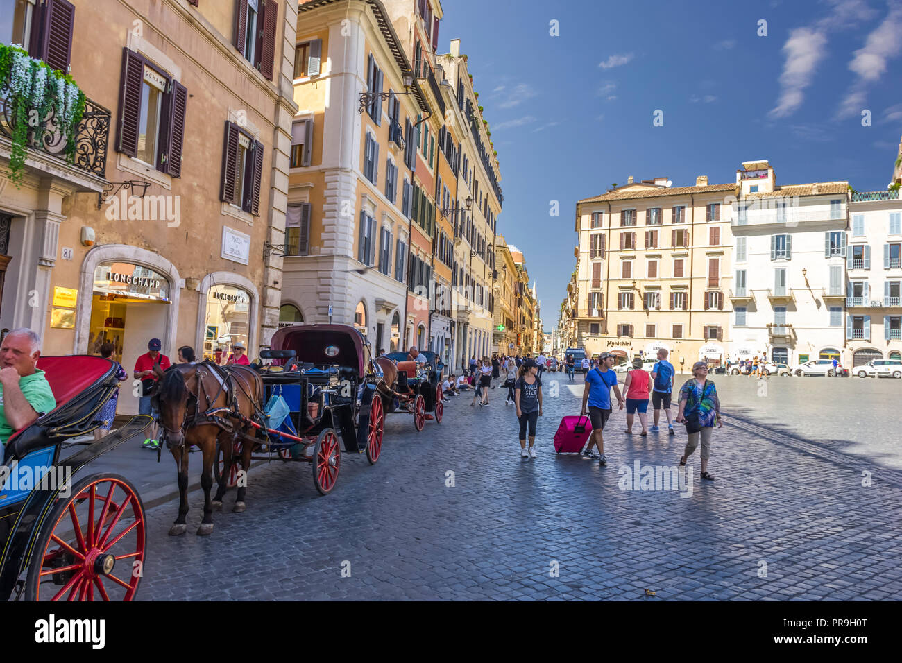 Rome/Italy - August 27, 2018: Piazza di Spagna with horse-waggons and tourists - Stock Image
