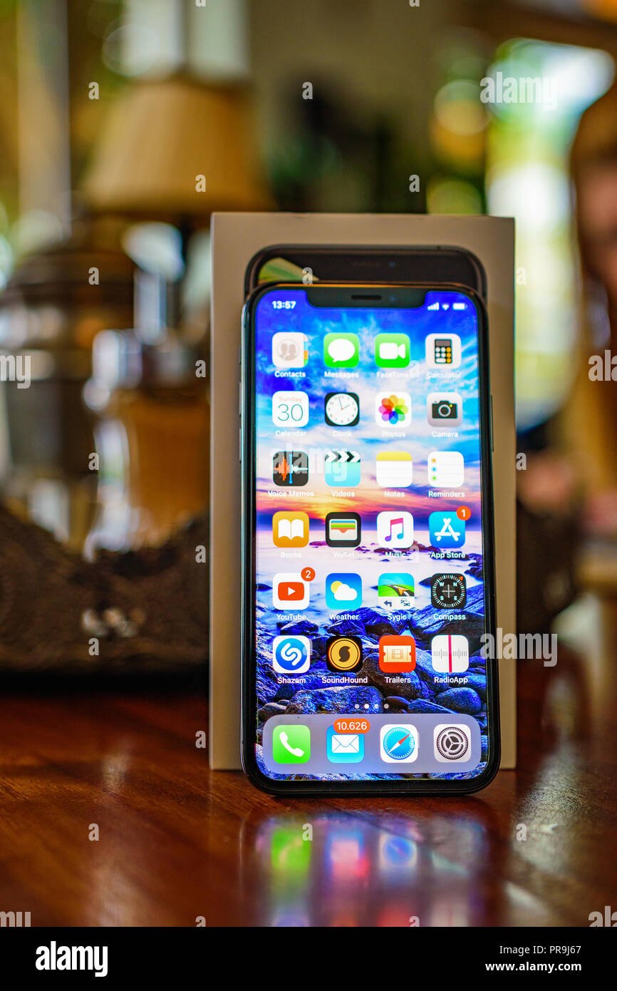 KALAMATA, GREECE - SEPTEMBER 30 2018: Close up photo of the Iphone XS model. The new Apple ten S in black color on a vintage wooden desk - Stock Image