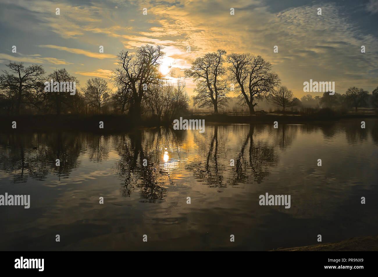 Winter Sun Rise over lake - Stock Image