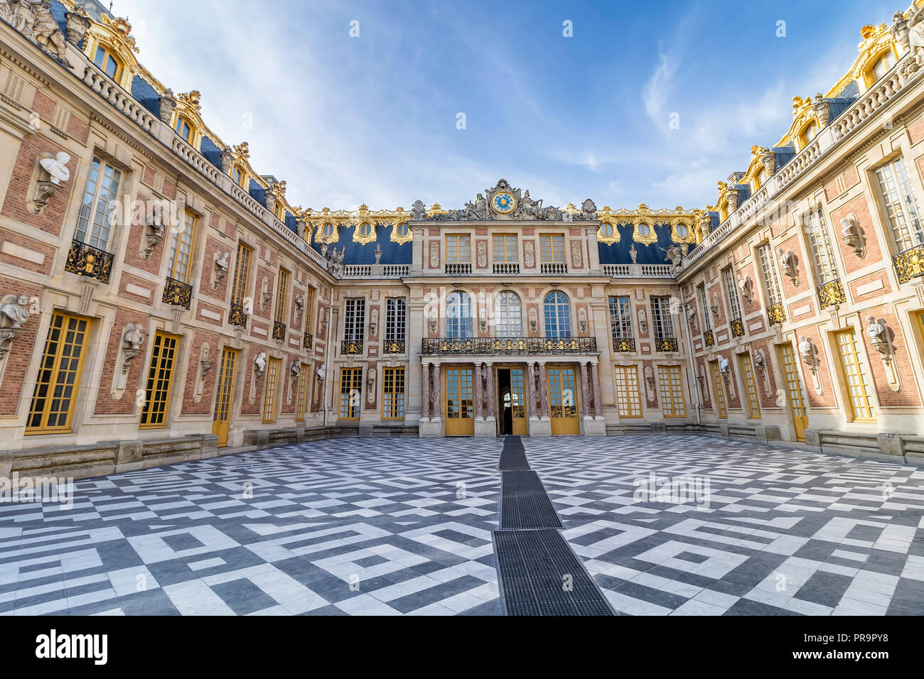 Facade of Chateau de Versailles (Palace of Versailles) near Paris. Palace Versailles was a royal chateau. - Stock Image